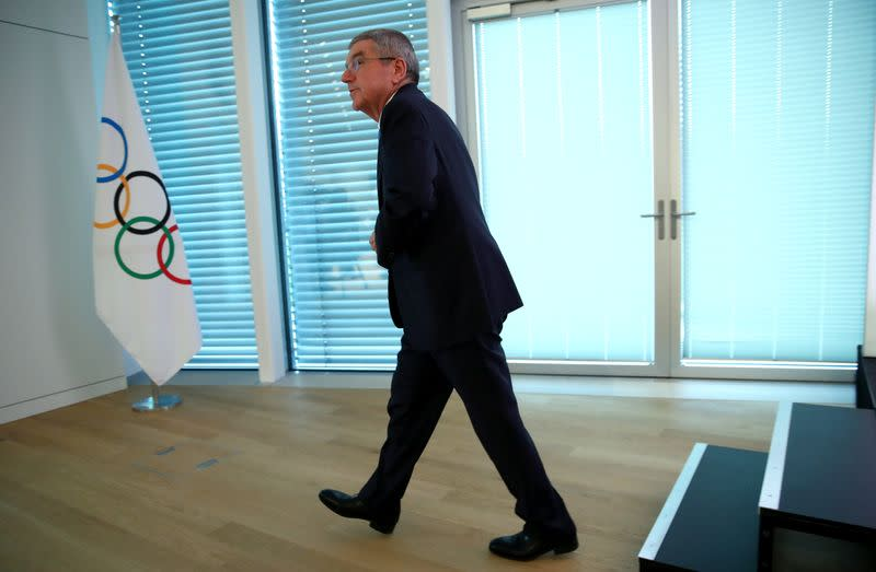 IOC President Bach leaves after a news conference in Lausanne