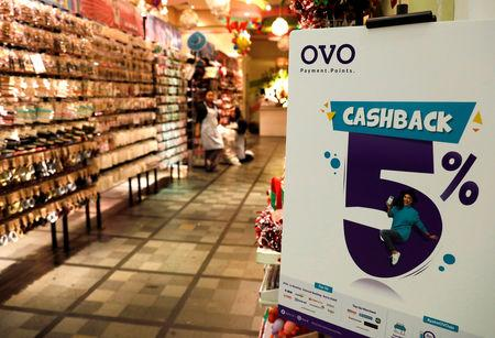 A sign of OVO payment is seen at a mall in Jakarta, Indonesia, November 8, 2018. Picture taken November 8, 2018. REUTERS/Beawiharta