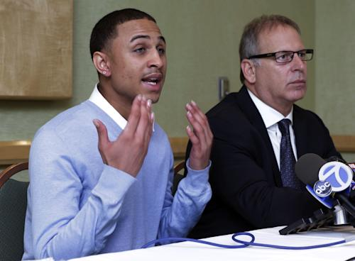 "Sheldon Stephens, left, accompanied by his attorney Jeff Herman, addresses a news conference, in New York, Tuesday, March 19, 2013. Stephens, 24, of Harrisburg, Pa., has filed suit against Kevin Clash, former voice of the ""Sesame Street"" character Elmo, claiming the entertainer lured him into drug-fueled sex when he was 16. (AP Photo/Richard Drew)"