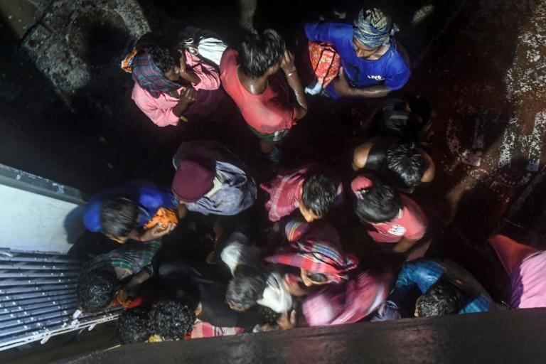 Villagers enter a building to take shelter in Bakkhali, India as Cyclone Bulbul approached