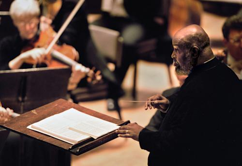 In this 2002 photo, Oregon Symphony music director James DePreist conducts from the podium for the first time since kidney transplant surgery in Portland, Ore. DePreist, one of the first African-American conductors and a National Medal of Arts winner, died Friday, Feb. 8, 2013 at his home in Scottsdale, Ariz., his manager Jason Bagdade said. (AP Photo/The Oregonian, Steven Nehl) MAGS OUT; TV OUT; LOCAL TV OUT; LOCAL INTERNET OUT; THE MERCURY OUT; WILLAMETTE WEEK OUT; PAMPLIN MEDIA GROUP OUT