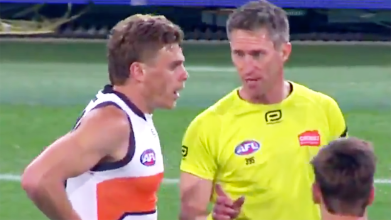 Adam Kennedy is pictured being warned by field umpire Shaun Ryan to stop targeting the injured elbow of Brisbane Lions forward Charlie Cameron. Picture: AFL/Channel 7