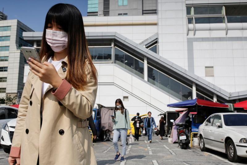 Taiwan's carrot-and-stick approach to virus fight wins praise, but strains showing