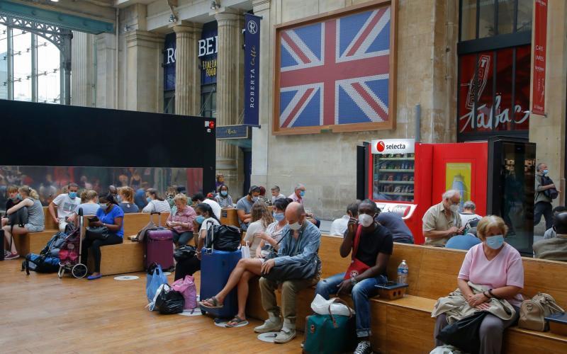 Passengers wait next to the Eurostar Terminal at the Gare du Nord train station in Paris - AP Photo/Michel Euler