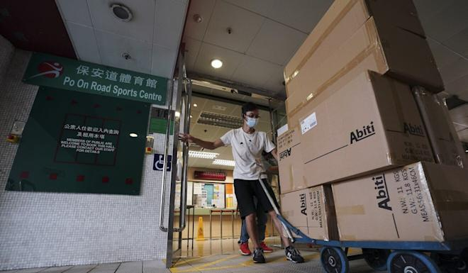 A worker delivers supplies on Sunday to the Po On Road Sports Centre in Cheung Sha Wan, where a makeshift Covid-19 community screening centre is being set up. Photo: Felix Wong