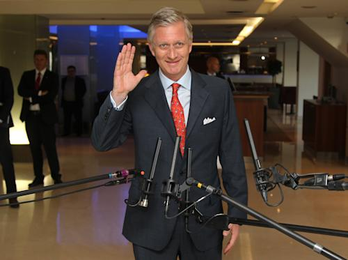 Belgian Crown Prince Philippe waves to the media upon arrival at a conference in Antwerp, Belgium, Thursday, July 4, 2013. Weighed down by the years, Belgium's King Albert announced Wednesday that he will hand the throne of his fractious kingdom to his son, Philippe, on the country's national holiday, July 21. (AP Photo/Yves Logghe)