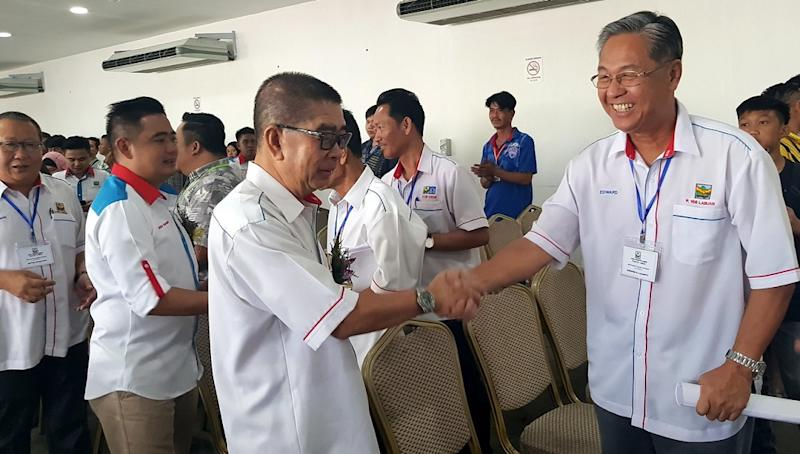 Datuk Seri Dr Maximus Ongkili (centre) is said to be recuperating from ailments brought on by exhaustion, with Radin tasked with leading PBS' preparation for the election. — Bernama pic