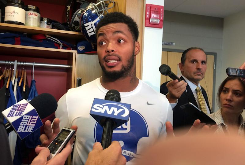 New York Giants linebacker Jonathan Casillas speaks Thursday, Sept. 28, 2017, in the NFL football team's locker room in East Rutherford, N.J., about a meeting with Commissioner Roger Goodell. Goodell held a round-table meeting with roughly 25 owners, league executives and players on Tuesday, Sept. 26, 2017, to discuss the national anthem demonstrations. (AP Photo/Tom Canavan)