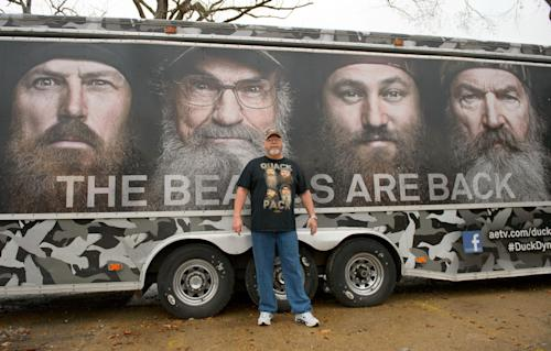 "Howell Henderson of Joplin, Mo., poses for a picture outside the Duck Commander store in West Monroe, La. Saturday, Dec. 21, 2013. The town is the setting for the popular ""Duck Dynasty""series, where show patriarch, Phil Robertson, was suspended last week for disparaging comments he made to GQ magazine about gay people. (AP Photo/Matthew Hinton)"