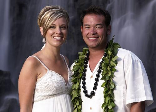 "FILE - This 2008 file image released by TLC, shows Jon Gosselin, right, and his wife Kate Gosselin, from the TLC series ""Jon & Kate Plus 8,"" in Hawaii. Kate Gosselin has filed a lawsuit accusing her ex-husband, Jon, of stealing her hard drive and hacking into her phone and computer to get material for a tell-all book. The federal lawsuit says he took the material for a book called ""Kate Gosselin: How She Fooled the World."" The suit, filed Monday, Aug. 26, 2013, in Philadelphia, says the book was written by her ex-husband's friend, tabloid writer Robert Hoffman, but has since been pulled from Amazon because the material was obtained illegally. (AP Photo/TLC, Mark Arbeit)"