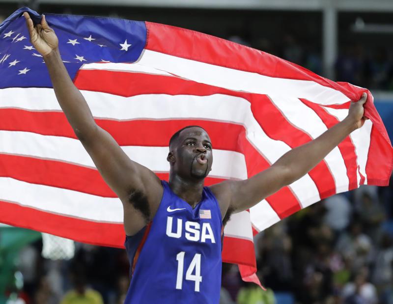 United States' Draymond Green (14) celebrates winning the men's basketball gold medal at the 2016 Summer Olympics in Rio de Janeiro, Brazil, Sunday, Aug. 21, 2016. (AP Photo/Matt York)
