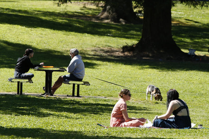 People spend time in at East Portal Park in Sacramento, Calif., Thursday, April 2, 2020. California has been under a mandatory stay-at-home order for more than a week to help curb the spread of the coronavirus. (AP Photo/Rich Pedroncelli)