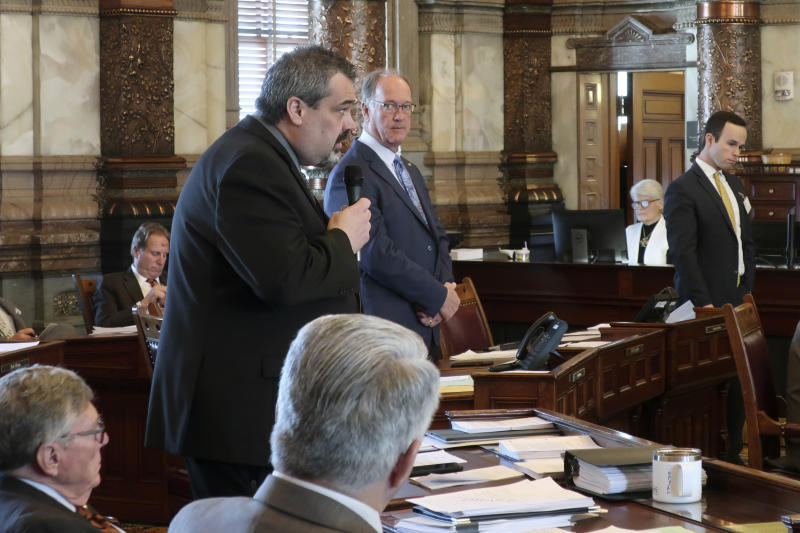Kansas state Sen. Richard Hilderbrand, left, R-Galena, makes a point during a debate on a bill that would legalize sports betting as Senate Vice President Jeff Longbine, R-Emporia, watches, Wednesday, Feb. 26, 2020, at the Statehouse in Topeka, Kan. The measure would allow four state-owned casinos to offer sports betting as a part of the Kansas Lottery. (AP Photo/John Hanna)