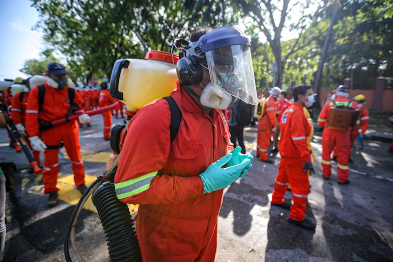 DBKL and Alam Flora personnel prepare to sanitise the area around the Sri Petaling Mosque March 28, 2020. ― Picture by Hari Anggara
