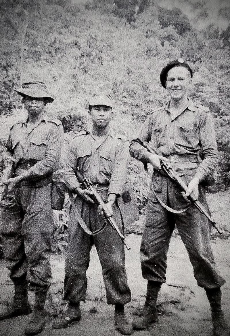 Lt. Peter Julius with two of his men, Ahmad (left) and Wahab (centre) at the swamp in Kebun Bahru, Pagoh, Johor in May 1956. — Picture courtesy of Peter Julius