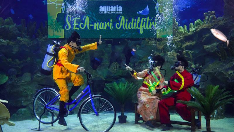 The oceanarium's divers will be dressed to the nines during the Hari Raya feeding sessions at Aquaria. — Picture courtesy of Aquaria KLCC