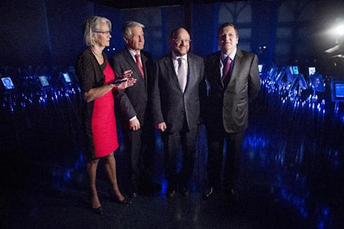 From left: Executive Director of the Nobel Peace Center Bente Erichsen, Chair of the Norwegian Nobel Committee Thorbjorn Jagland, European Parliament President Martin Schulz and European Commission President Jose Manuel Barroso, pictured during the opening of an exhibition in the Nobel Peace Center in Oslo Tuesday, Dec 11, 2012. (AP Photo / Thomas Winje Oijord, NTB Scanpix) NORWAY OUT