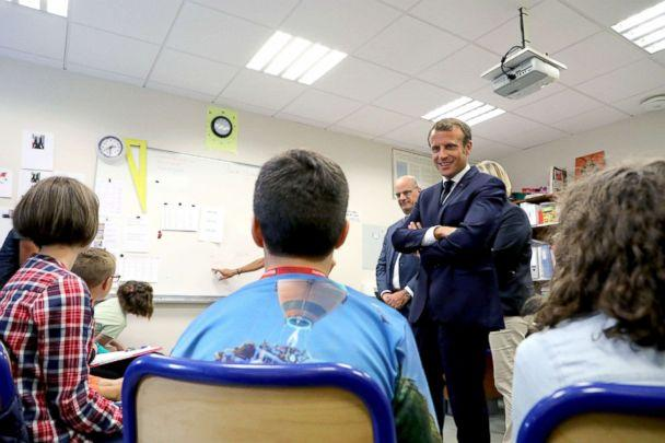 PHOTO: French president Emmanuel Macron, flanked by French Education Minister Jean-Michel Blanquer, speaks with the pupils of the localised educational inclusion units class at the Jules Renard secondary school in Laval, France, Sept. 3, 2018. (Ludovic Marin/Reuters)