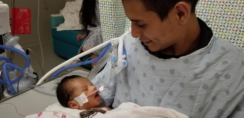 Yovavi Lopez was photographed gazing adoringly at his infant son. Source: Facebook/Cecilia Garcia