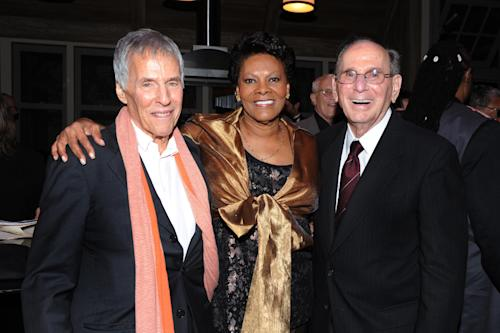 "FILE - This Oct. 17, 2011 file photo shows legendary songwriters Bert Bacharach, left, and Hal David pose with singer Dionne Warwick at the ""Love, Sweet Love"" musical tribute to Hal David on his 90th birthday in Los Angeles, Calif. David, who along with partner Burt Bacharach penned dozens of top 40 hits for a variety of recording artists in the 1960s and beyond, died Saturday Sept. 1, 2012 in Los Angeles. (AP Photo/Vince Bucci, File)"