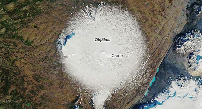 Photo shows Okjökull glacier covered in white snow in 1986 NASA photo.
