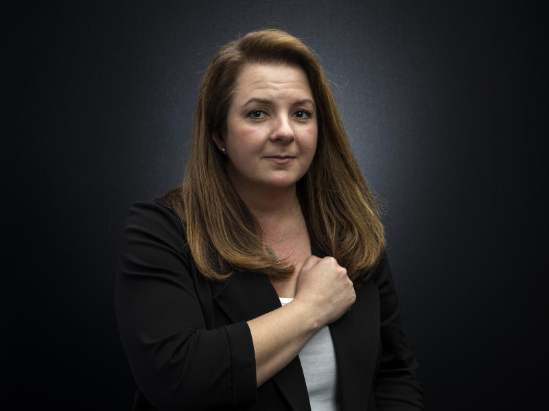 """This March 16, 2020 photo shows event producer Heather Hope-Allison posing for a portrait in Los Angeles. Earlier this month, Hope-Allison and her husband, Steve were putting together the schedule for the ninth season of Street Food Cinema, a six-month series of events in the Los Angeles area featuring film indoor and outdoor screenings, food trucks and musical acts. But when Los Angeles Mayor Eric Garcetti announced a citywide """"Safer At Home"""" order, shutting down all nonessential businesses due to the coronavirus, it became unclear whether she would be hosting any kind of season at all. (Photo by Willy Sanjuan/Invision/AP)"""