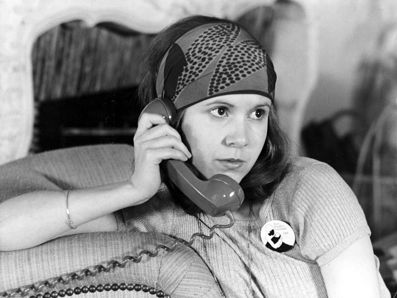 Carrie Fisher chatted on the phone in a scene from her first film, 1975's <em>Shampoo</em>.