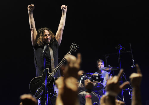 FILE - This Feb. 15, 2013 file photo shows Chris Cornell of Soundgarden during the band's concert at the Wiltern in Los Angeles. Soundgarden will perform at the iTunes Music Festival at SXSW on March 13, in celebration of the 20th Anniversary of Superunknown LP.(Photo by Chris Pizzello/Invision/AP, File)