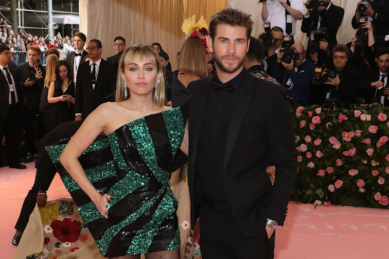 Miley Cyrus and Liam Hemsworth pose for the camera at the Met Gala