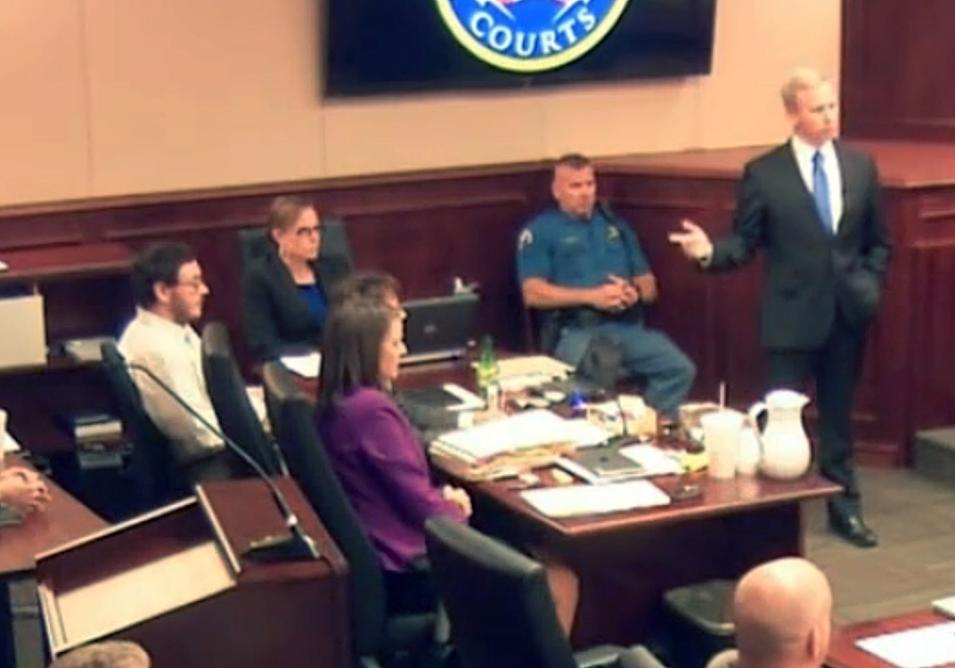In this image taken from Colorado Judicial Department video, prosecutor George Brauchler, right, gestures toward Colorado theater shooter James Holmes, left, while delivering an opening statement in phase two of the sentencing hearings inside Arapahoe County District Court, where Holmes' trial continued Thursday, July 23, 2015, in Centennial, Colo. The afternoon saw the conclusion of phase one of the penalty hearings in the trial of Holmes, with the judge reading the jury's decision that Holmes is eligible for the death penalty. (Colorado Judicial Department via AP, Pool)