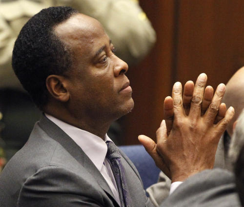 Dr. Conrad Murray sits in court after he was sentenced to four years in county jail for his involuntary manslaughter conviction in the death of pop star Michael Jackson on Tuesday, Nov. 29, 2011 in Superior Court in Los Angeles. (AP Photo/Mario Anzuoni, Pool)