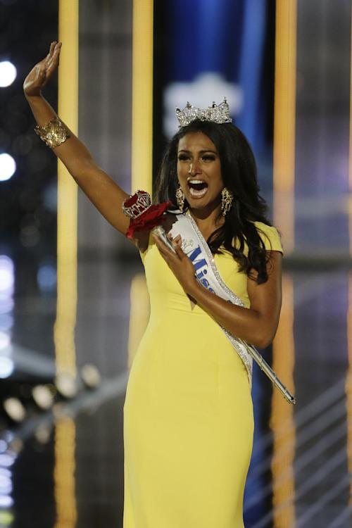 Miss New York Nina Davuluri walks down the runway after winning the the Miss America 2014 pageant, Sunday, Sept. 15, 2013, in Atlantic City, N.J. (AP Photo/Mel Evans)
