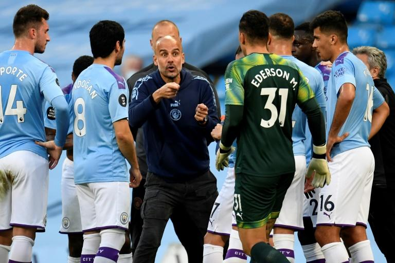 Guardiola says he has to earn new Man City contract