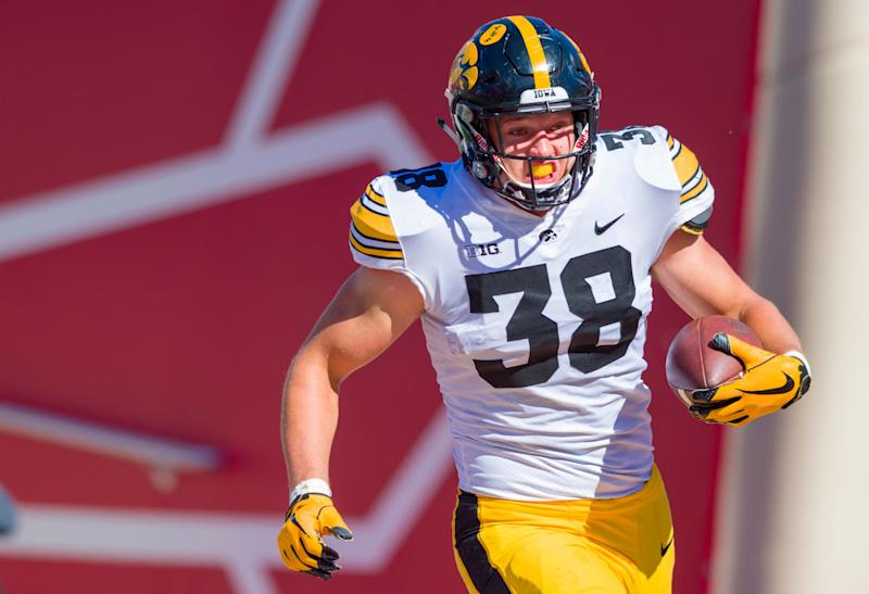 Iowa tight end T.J. Hockenson (38) rushes the ball into the end zone to score during the second half of an NCAA college football game against Indiana Saturday, Oct. 13, 2018, in Bloomington, Ind. Iowa won 42-16. (AP Photo/Doug McSchooler)