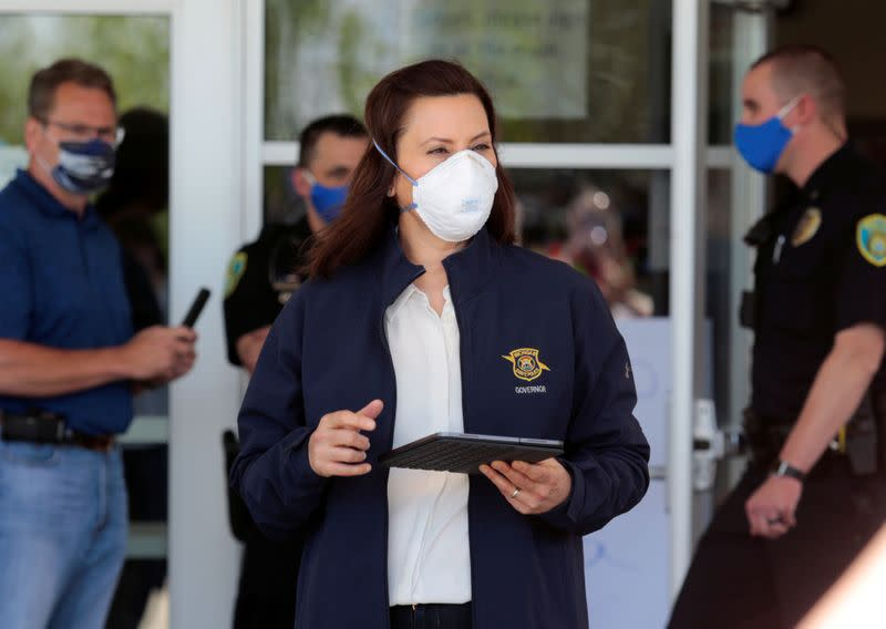 FILE PHOTO: Michigan Governor Gretchen Whitmer wears a face mask as she arrives to address the media about the flooding along the Tittabawassee River, after several dams breached, in downtown Midland