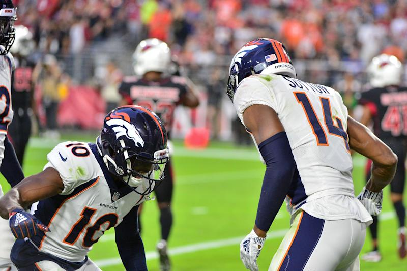 Oct 18, 2018; Glendale, AZ, USA; Denver Broncos wide receiver Emmanuel Sanders (10) and wide receiver Courtland Sutton (14) celebrate after connecting for a touchdown during the first half against the Arizona Cardinals at State Farm Stadium. Mandatory Credit: Matt Kartozian-USA TODAY Sports