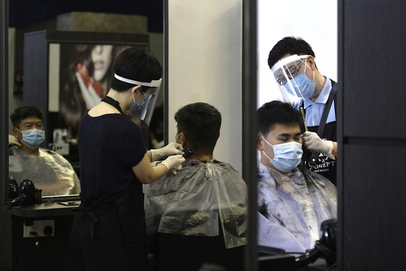 A customer gets his hair cut at the K Concept hair salon in Publika, Kuala Lumpur June 10, 2020. — Picture by Miera Zulyana