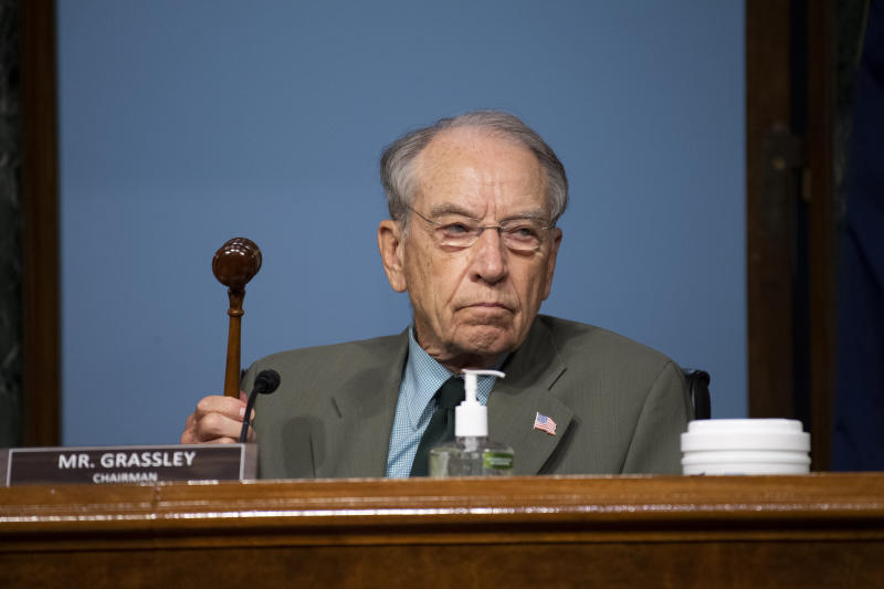 """Chairman Chuck Grassley, R-Iowa, holds up a gavel during a Senate Finance Committee hearing on """"COVID-19/Unemployment Insurance"""" on Capitol Hill in Washington on Tuesday, June 9, 2020. (Caroline Brehman/CQ Roll Call/Pool via AP)"""