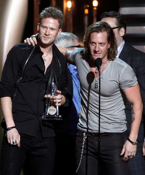 "Tyler Hubbard, right, and Brian Kelley, of Florida Georgia Line, accept the award for single of the year for ""Cruise"" at the 47th annual CMA Awards at Bridgestone Arena on Wednesday, Nov. 6, 2013, in Nashville, Tenn. (Photo by Wade Payne/Invision/AP)"
