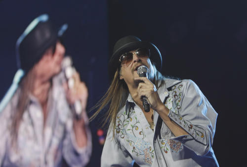 FILE - In a Jan. 15, 2011 file photo, Kid Rock performs at Ford Field in Detroit. The musician is known for dabbling in all kinds of musical genres: hip-hop, hard rock, country and Southern rock. Classical? Not so much. But he jumped at the chance to play a show with the Detroit Symphony Orchestra on Saturday, May 12, 2012. The concert is designed to raise some much-needed cash for the DSO, which has been on shaky financial ground in recent years. (AP Photo/Carlos Osorio, File)