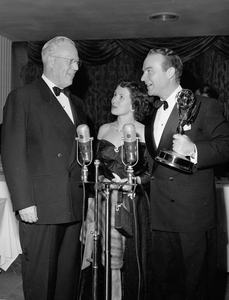 <p>California Governor Earl Warren awards Ralph Edwards and his wife Barbara for the game show <em>Truth or Consequences.</em></p>