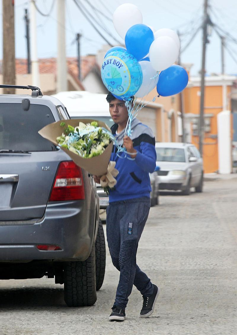 Blue balloons and a massive bunch of flowers were delivered to Thomas Markle's house in Mexico. Photo: Splash News/Media Mode