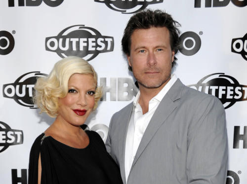 "FILE - In this July 7, 2011 file photo, actress Tori Spelling, left, and actor Dean McDermott arrive at the premiere of the feature film ""Gun Hill Road"" in Los Angeles. McDermott has entered rehab for an unspecified treatment, his publicist Jill Fritzo confirms. In a statement to People, who first reported the story, McDermott says, ""I am truly sorry for the mistakes I have made and for the pain I've caused my family."" He goes on to say he's being treated for ""some health and personal issues."" Forty-seven year old McDermott and 40-year-old Spelling were married in 2006 after meeting on the set of a TV movie in Canada. (AP Photo/Dan Steinberg, File)"