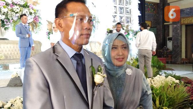 IPTU Mansur dan Istri