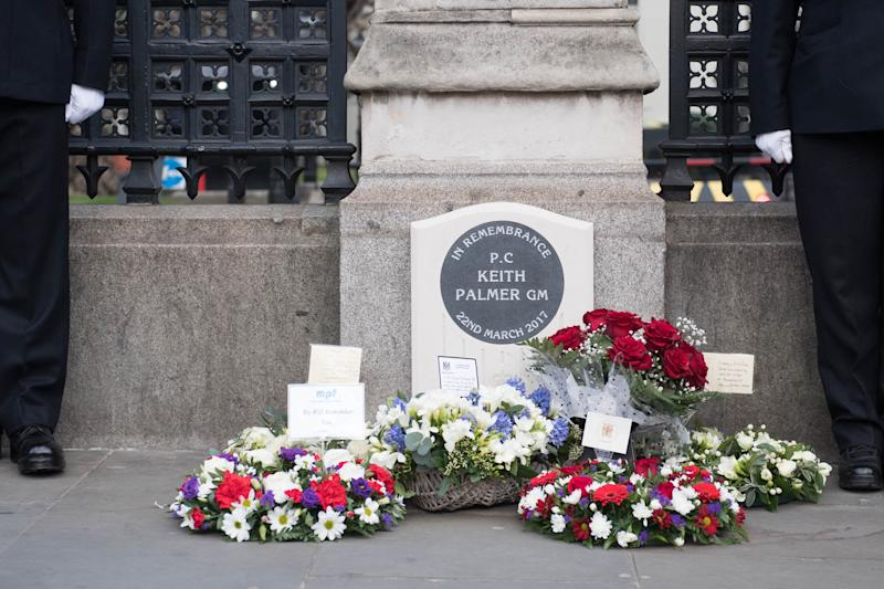 Floral tributes at the unveiling of a national memorial outside the Carriage Gates, at the Palace of Westminster, in memory of Pc Keith Palmer, who was killed during a terrorist incident in Westminster in 2017.