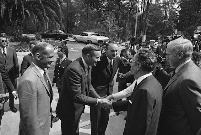 President Gustavo Diaz Ordaz of Mexico, right, and his wife, oscured by the President, greet U.S. Apollo 11 astronaut Neil Armstrong on he arrival, Monday, Sept. 29, 1969 in Mexico City of the moon travelers at the residence of the Mexican first family of Los Pinos. Watching the double handshake are Edwin Aldrin, left, and Michel Collins. (AP Photo)