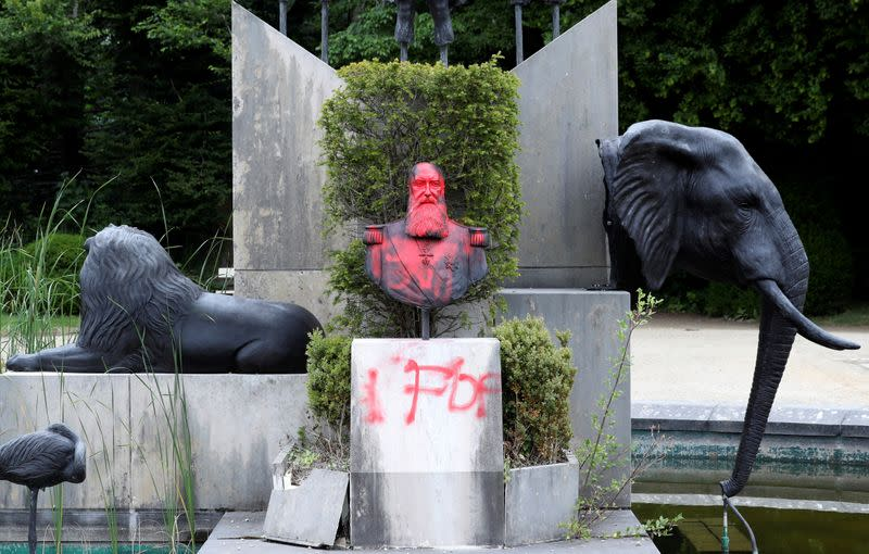 A statue of former Belgian King Leopold II sprayed with a graffiti is seen in the park of the Africa Museum, in Tervuren, near Brussels