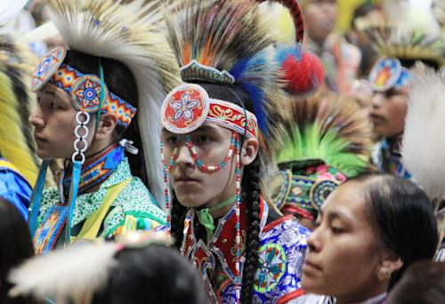 Native American and indigenous dancers participate in the grand entry at the 30th annual Gathering of Nations in Albuquerque, N.M., on Friday, April 26, 2013. The powwow draws hundreds of competitive dancers and tens of thousands of spectators each year. (AP Photo/Susan Montoya Bryan)