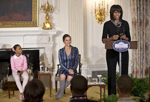 First lady Michelle Obama speaks at a gathering in the State Dining Room of the White House in Washington, Wednesday, Feb. 13, 2013, during a celebration of the Black History Month, welcoming middle and high school students from the District of Columbia area and New Orleans taking part in an interactive student workshop with the cast and crew of the film Beasts of the Southern Wild. From left are, Quvenzhané Wallis and Rachel Goslins. (AP Photo/Manuel Balce Ceneta)