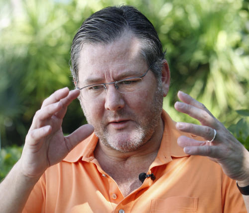 FILE - In this feb. 24, 2012 file photo, chef Charlie Trotter gestures as he speaks during an interview with The Associated Press in Miami Beach, Fla. Officials in Chicago said Tuesday, Nov. 5, 2013, that Trotter has died. (AP Photo/Wilfredo Lee, File)